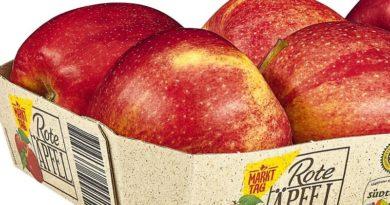 netto verpackt Äpfel in Verpackungen mit Grasanteil